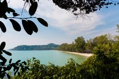 Tropical landscape of Koh Kood. Summer landscape on tropical koh Kood island in Thailand. Panorama of white sand beach with coconut palms taken on Klong Chao Stock Photo