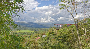 Tropical landscape. A tropical mountain side with lush green fields taken in the distance taken in sauce,  tarapoto, san martin, Peru Royalty Free Stock Image