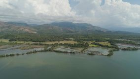 Tropical landscape, mountains, lake. Aerial view Lake Uacon on the background of mountains located Zambales Philippines, Luzon. Mountain landscape with lake stock footage