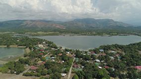 Tropical landscape, mountains, lake. Aerial view Lake Uacon on the background of mountains located Zambales Philippines, Luzon. Mountain landscape with lake stock video