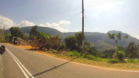 Tropical landscape from moving vehicle down the road in beautiful Sri Lanka. stock video