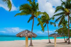 Tropical landscape Playa Esmeralda, Holguin, Cuba. Caribbean sea. Beautiful Paradise beach: umbrellas, sea, palm trees, sand. Tropical landscape Playa Esmeralda royalty free stock photography