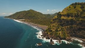 Tropical landscape, sea, beach, mountains. Aerial view sea coast, ocean, mountains, sea, beach, sky, clouds. Bali, Indonesia. Seascape with Seashore on the stock footage
