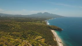 Tropical landscape, sea, beach, mountains. Aerial view sea coast, ocean, mountains, sea, beach, sky, clouds. Bali, Indonesia. Seascape with Seashore on the stock video footage