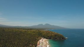 Tropical landscape, sea, beach, mountains. Aerial view sea coast, ocean, mountains, sea, beach, sky, clouds. Bali, Indonesia. Seascape with Seashore on the stock video footage