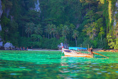 Tropical landscape, traditional long tail boat, Thailand Phi-Phi Stock Photos