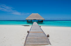 Tropical landscape with wooden bridge and hut on the water at Maldives Royalty Free Stock Images