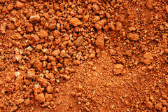 Red earth or soil background. Tropical laterite soil or red earth background Royalty Free Stock Photo