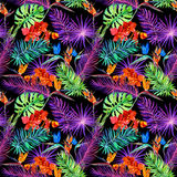 Tropical leaves, exotic flowers in neon glow. Repeating hawaiian pattern. Watercolor Stock Image