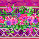 Tropical leaves and flowers on ornamental background. Floral vivid background. Stock Images