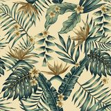 Tropical leaves and gold flowers seamless beige background royalty free stock photo
