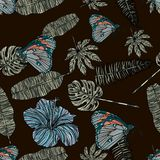 Tropical leaves, hibiscus and butterfly seamless pattern. Stock Photos