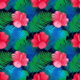 Tropical leaves pattern with flowers. Stock Photo