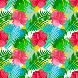Tropical leaves pattern with flowers. Royalty Free Stock Photo