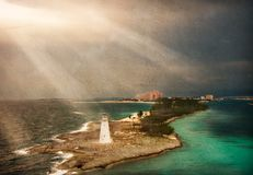 Tropical Lighthouse. With rays of light Stock Images
