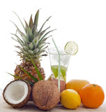 Tropical lime cocktail and fruits Stock Photo