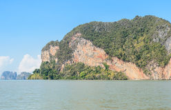 Tropical limestone island in sunny day. Landscapes of limestone island in Phang Nga Bay National Park, Thailand. Imagine as Wild boar and tiger image on cliff stock photography