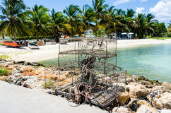 Tropical Lobster Pots. Lobster pots piled on a dock in in the Caribbean island of Anguilla Stock Images