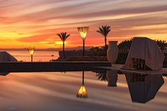 Tropical luxury tourist resort. Stunning evening view of Red Sea and colorful vibrant sky after sunset. stock photos