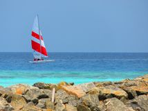 Tropical, Maldives and sail boat. View of a sail boat on the blue sea of Indian Ocean Stock Photo