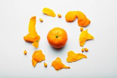 Tropical Mandarin on a white background with a peel in the shape of a circle royalty free stock images