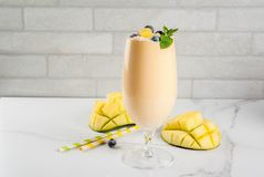 Tropical mango smoothie Royalty Free Stock Images