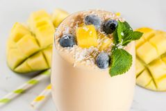 Tropical mango smoothie Royalty Free Stock Photos