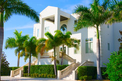 Tropical mansion luxury vacation house w palm trees Royalty Free Stock Photos
