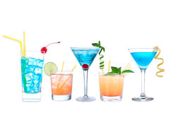 Tropical Martini cosmopolitan cocktails blue hawaiian and yellow. Margarita alcohol drinks isolated on a white background royalty free stock photography