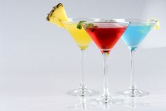 Tropical Martini style drinks with fruit & garnish Stock Photography