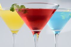 Tropical Martini style drinks with fruit & garnish Royalty Free Stock Image