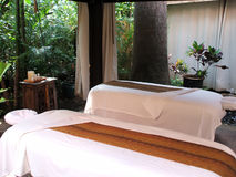 Tropical Massage. Luxurious tropical spa still life with outdoor massage tables Royalty Free Stock Photos