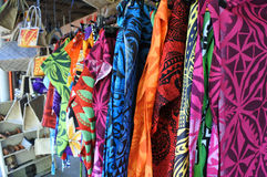 Tropical men shirts on display in the market Stock Image