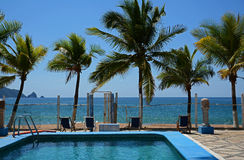 Tropical Mexican palm trees swimming pool ocean resort Stock Image