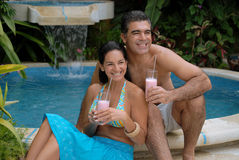 Tropical milkshake couple. Royalty Free Stock Images
