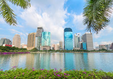 Tropical modern city with palm trees and lake on front Stock Image