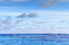 Tropical morning seascape in Maldives. Tropical morning seascape of the fresh blue sea water, blue sky and clouds in Maldives stock photo