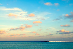 Tropical morning seascape in Maldives. Tropical morning seascape of the fresh blue sea water, blue sky and clouds in Maldives Royalty Free Stock Photos