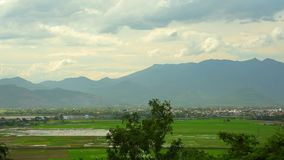 Tropical Mountain Range Landscape Scene Central Vietnam. Vietnamese mountain range landscape, with rice fields and lush green tropical vegetation running across stock footage