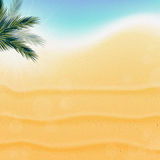 Tropical nature, warm Golden sand and the bright sun under. The leaves of a palm by the foam Royalty Free Stock Photography