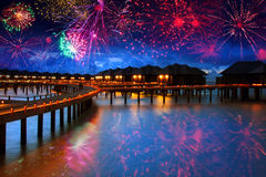 Tropical new suitable night. Festive New Year's fireworks over the tropical island Royalty Free Stock Images