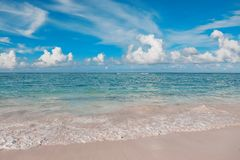 Tropical ocean beach and blue sky royalty free stock image