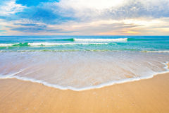 Tropical ocean beach sunrise or sunset Royalty Free Stock Images