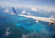 Tropical Ocean Over Plane Wing Royalty Free Stock Photo