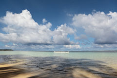 Tropical ocean with fishermen boat Royalty Free Stock Images