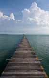 Tropical Ocean Pier stretching into sea Royalty Free Stock Photo