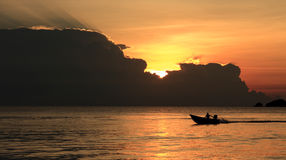 Tropical ocean sunset. Boat  on the ocean during a beautiful tropical ocean sunset, South East Asia Stock Photography