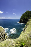 Tropical ocean view from the cliff top .small wave hitting the rock with blue sky background Royalty Free Stock Image