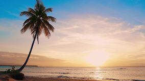 Tropical orange sun down by sea. Yellow sun and blue sky. Beautiful clouds over sea stock footage