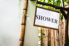 Tropical outdoor shower surrounded with bamboo walls Stock Image